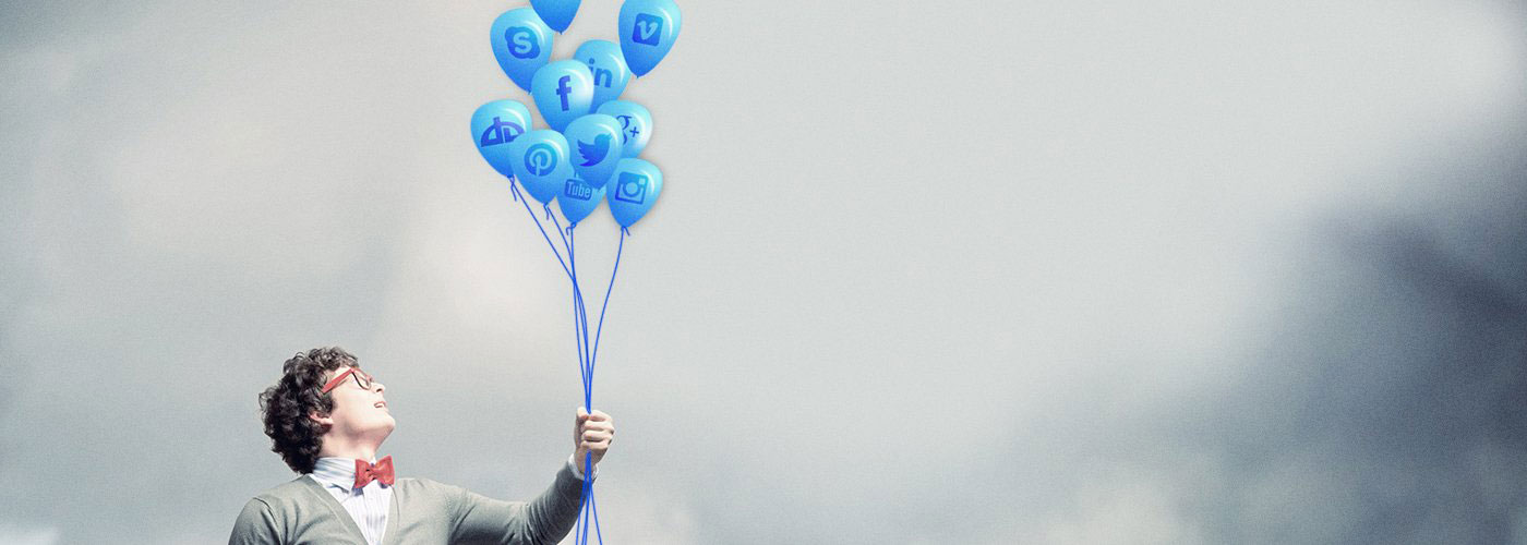 Man with digital marketing balloons